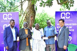 From L-R: Nicholas Katongole, Head of Public Health Quality Chemicals, Tito Okema, Bincentina Alal, their son together with Ajay Mahadik the General Manager of QCL after having over the termidor donation